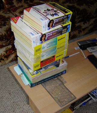 Symmetrical phone book stacking. No human would stack books this way. Or keep this many before throwing them out.