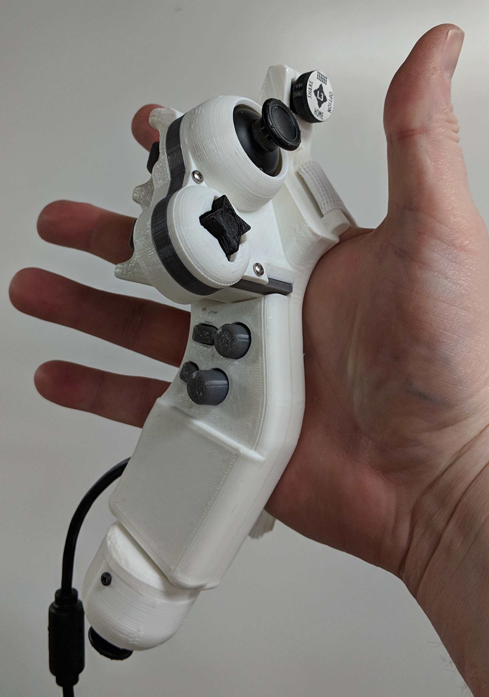 Just a quick note I finally found the time to finish the prototype! It's  based off the Hori PS4 Mini controller. Pictures and info below.
